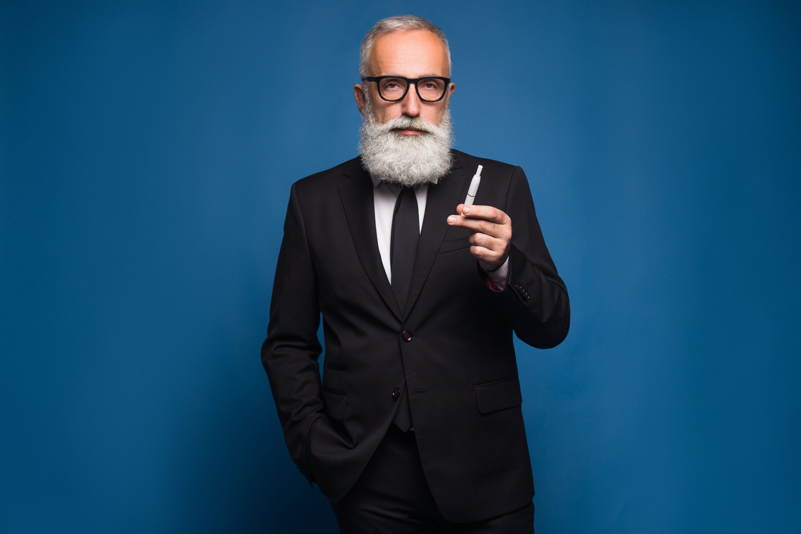 Bearded Business Man Smoking Electronic Cigarette In The Suit New Technology Of Healthy Smoking Of Electronic Vaping Cigarette